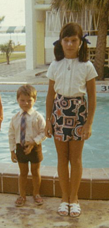 Torchwood star John Barrowman with his sister Carole Barrowman as young children